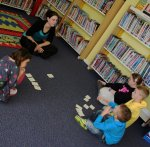 Children and storyteller in a library